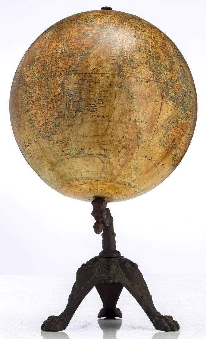 A terrestrial globe by J. Lebegue & Cie - Paris, on a - 2