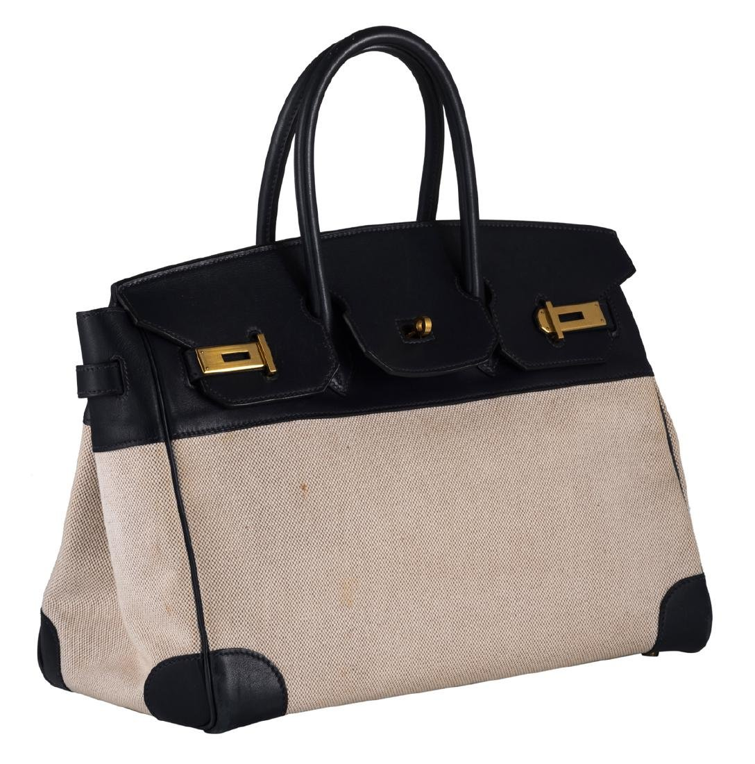 A Hermes Birkin bag in ebene leather and natural toile