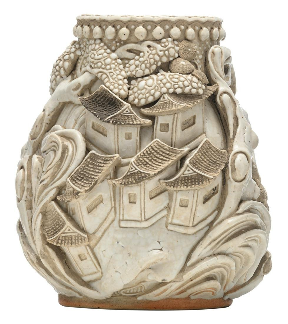 A Chinese stoneware vase, decorated with willow trees