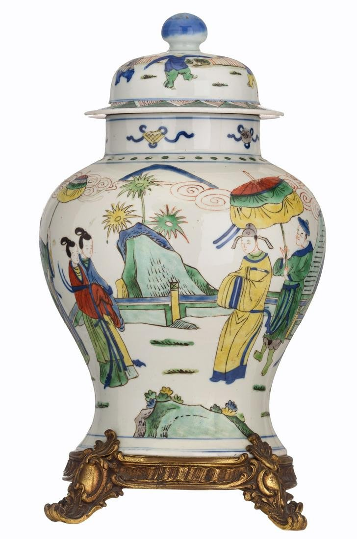A Chinese wucai vase and cover, decorated with a