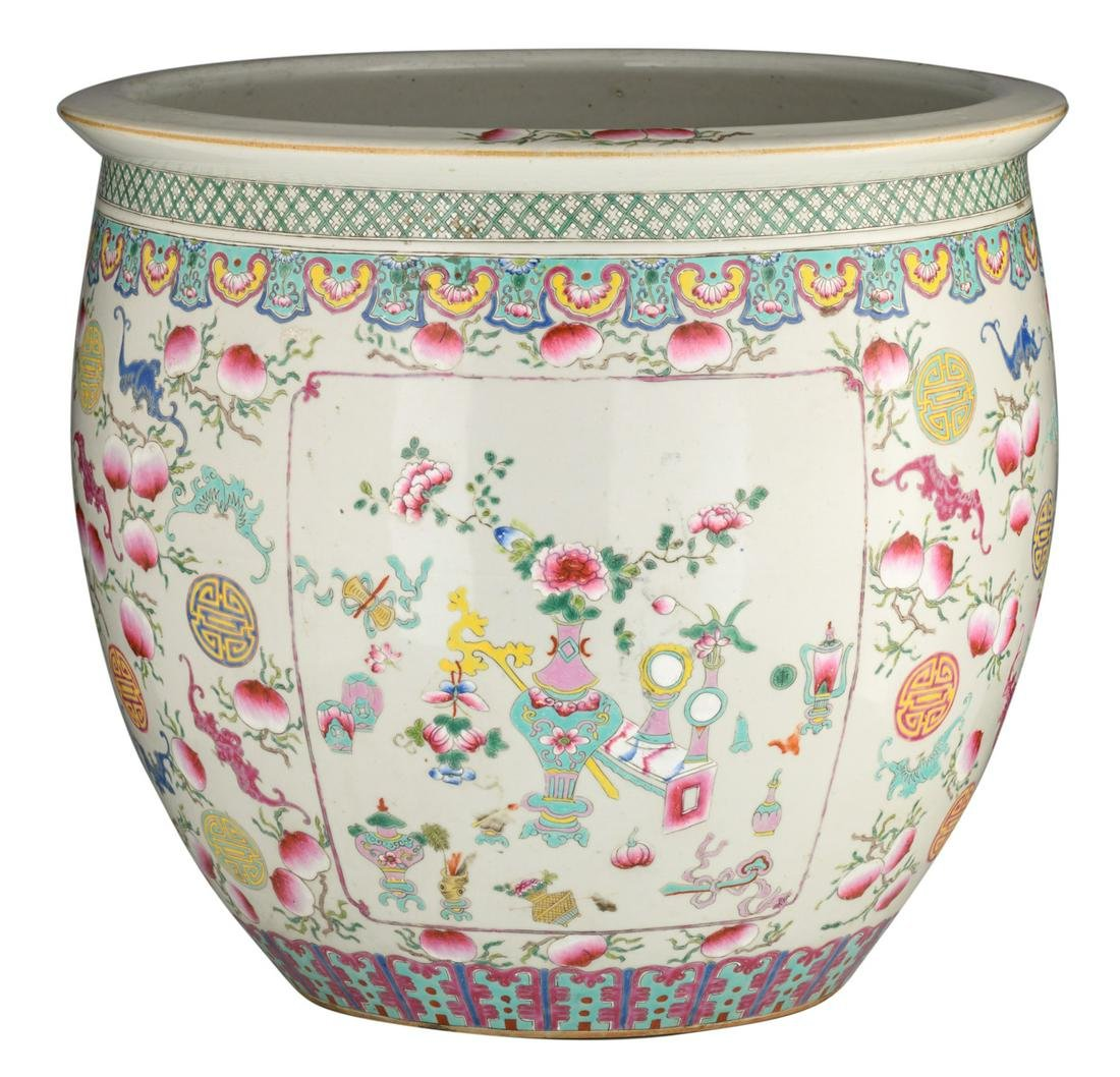 A large Chinese famille rose fish bowl, decorated with