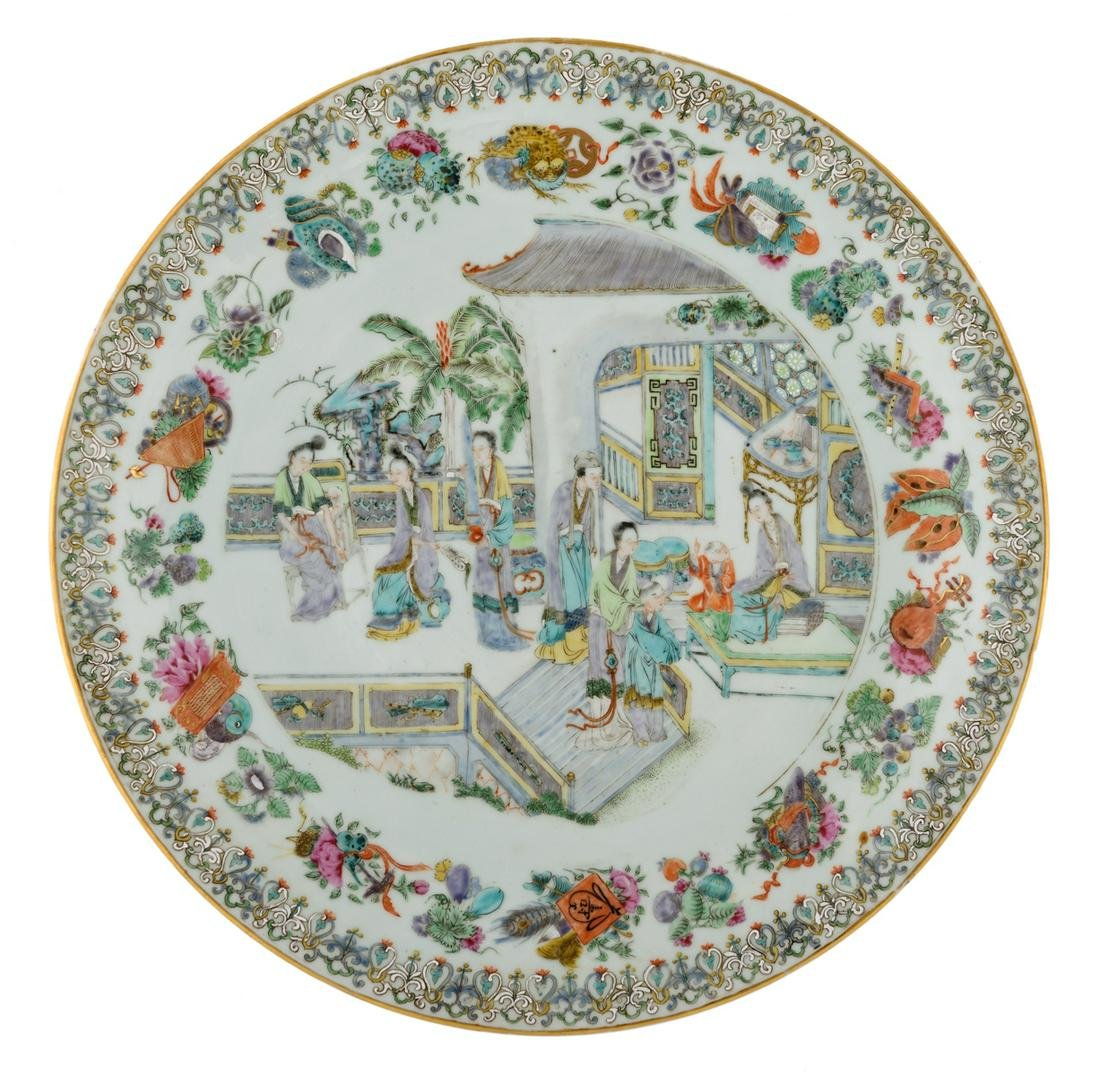 A Chinese famille rose plate, the centre decorated with