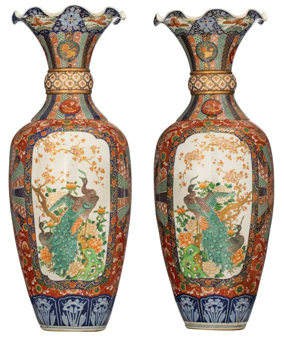 A pair of imposing Japanese brocade Imari ground vases,
