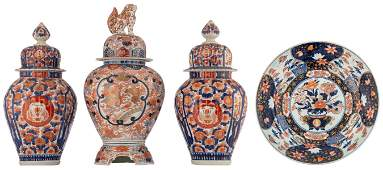 An Arita Imari charger the well decorated with a
