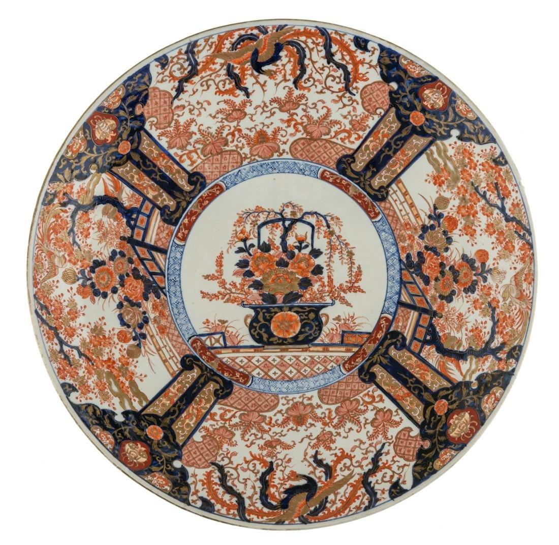 A large Japanese Arita Imari plate, the centre
