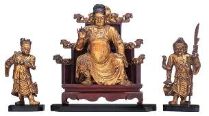 An Oriental gilt wooden seated figure on a throne