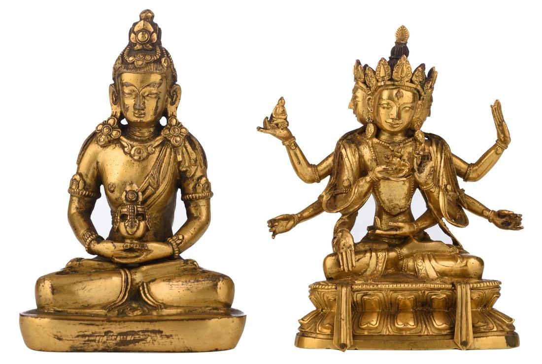 A Sino-Tibetan gilt bronze Buddha and a ditto three
