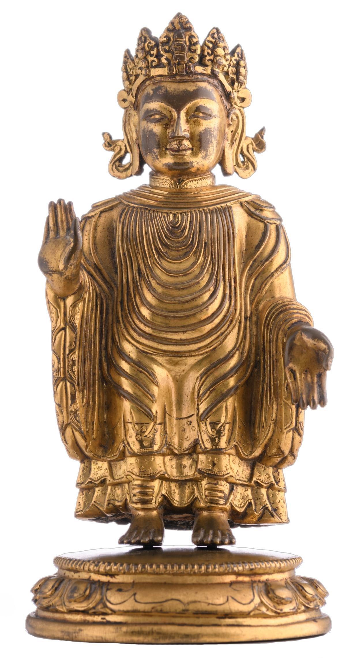 A Sino-Tibetan gilt bronze Buddha, the garment draped