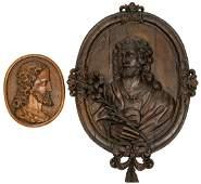 A large oval-shaped oak basso-relievo depicting Saint