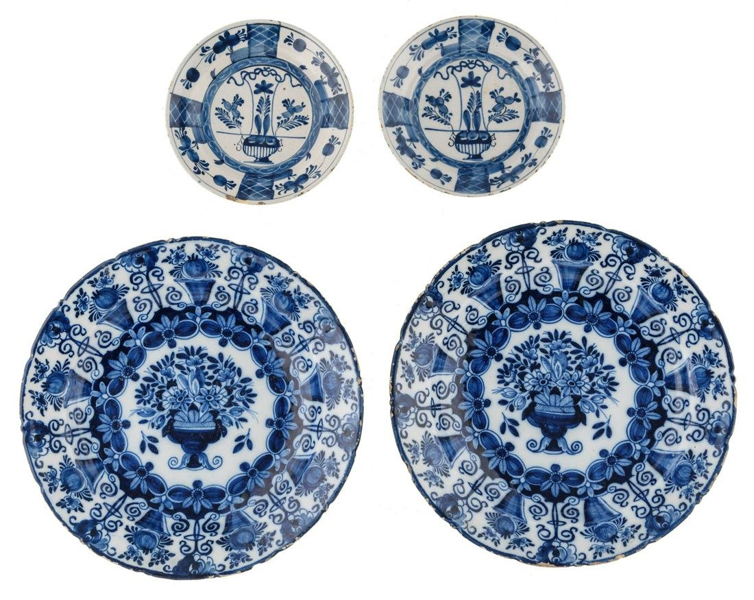 Two large Delftware dishes with a flower basket