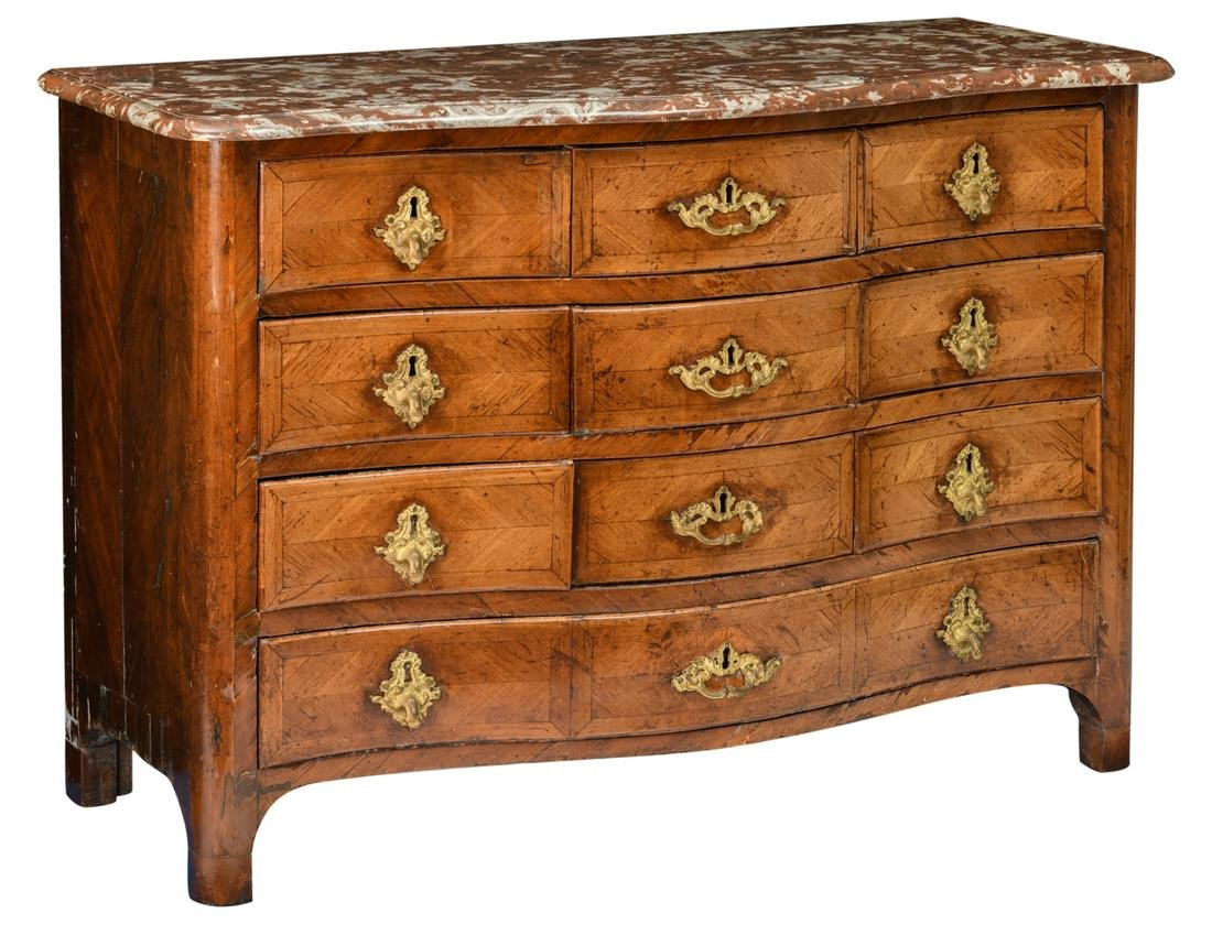 An 18thC French mahogany period regence commode, with