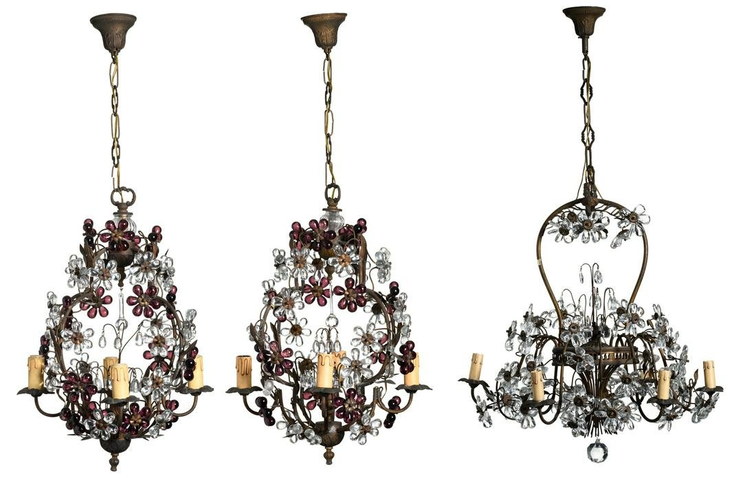 A pair of floral decorated brass chandeliers with
