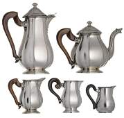 A three piece silver set in early Rococo style,
