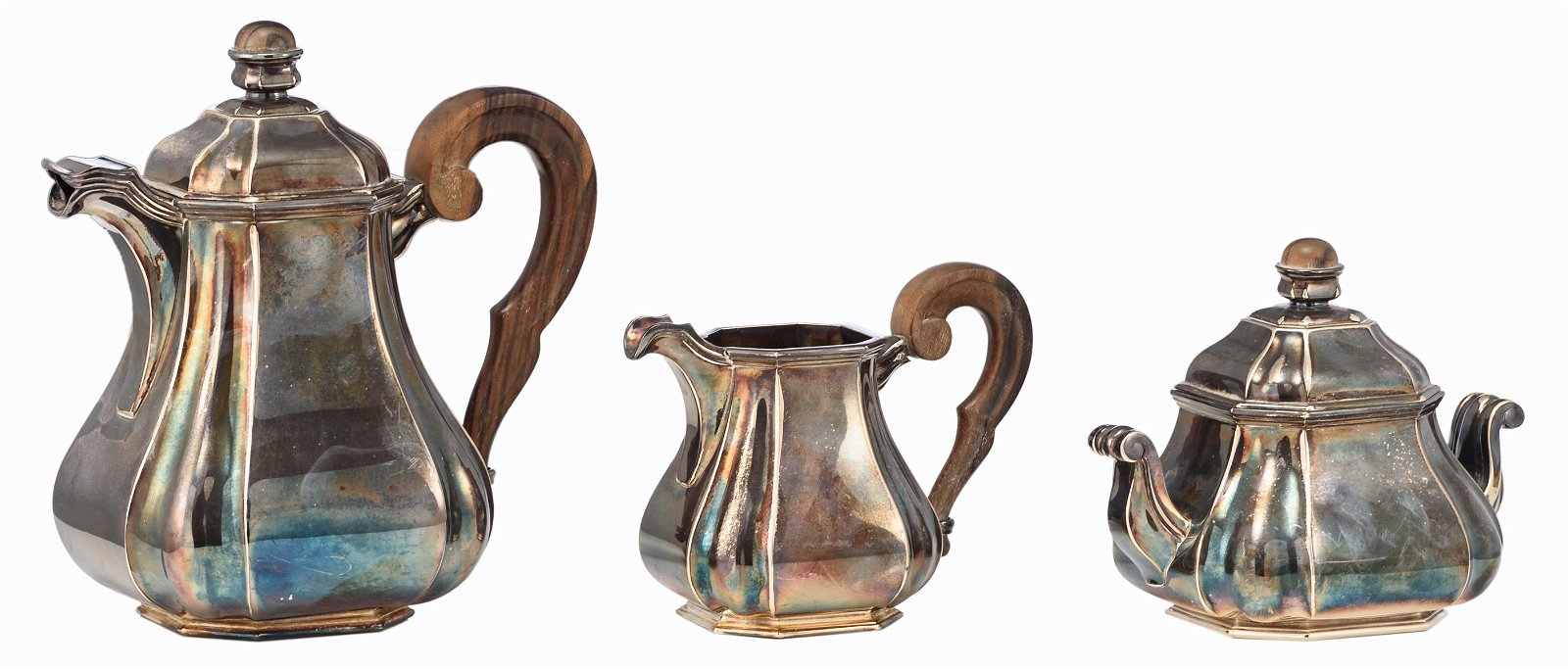 A silver three-part coffee set with walnut handles,