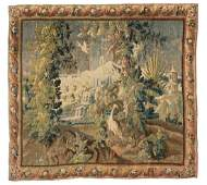 A 17thC Flemish verdure tapestry with exotic birds in a