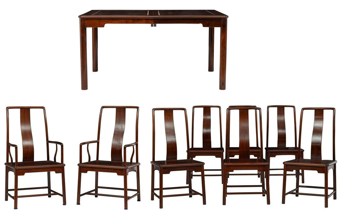 A fine Chinese rosewood extendable dining table with a