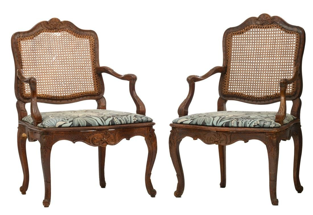 A pair of finely sculpted Louis XV armchairs, with