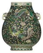 A Chinese black ground famille verte hu-vase, decorated