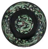A Chinese black ground and famille verte dish, both