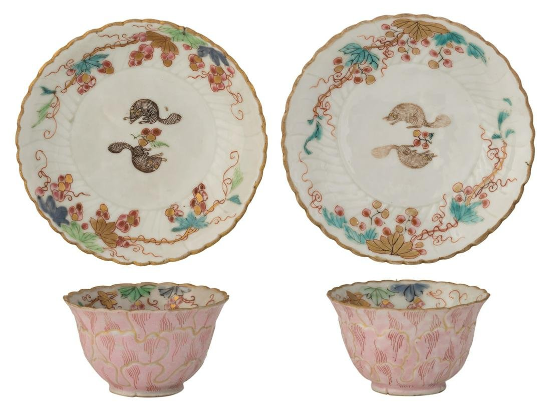A pair of Chinese relief famille rose and gilt cups and