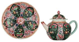 A Chinese famille rose black ground relief decorated