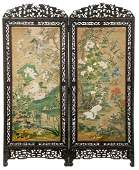 A Chinese richly carved hardwood twopanel screen the