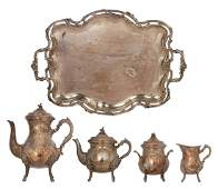A Wiskemann marked Rococo style four-piece silver