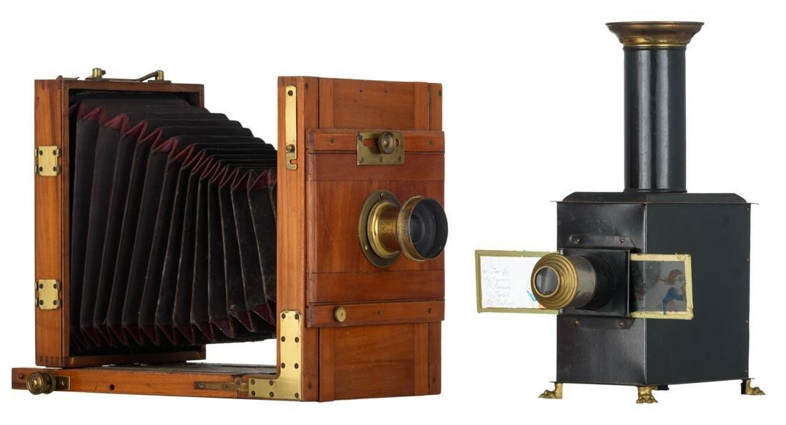 A mahogany folding camera, the lens marked 'Hermagis,