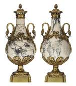 A pair of Neoclassical Carrara marble cassolettes with