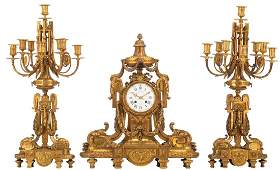 A Neoclassical three-piece gilt bronze garniture,
