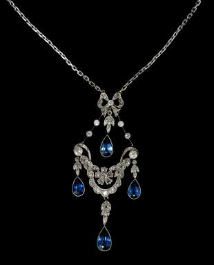 A Victorian sapphire and diamond pendant, the openwork