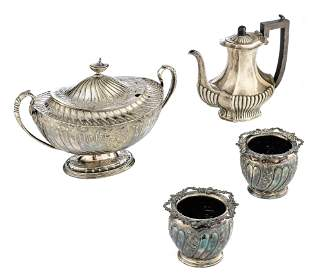 An English Neoclassical silver coffee pot with an ebony