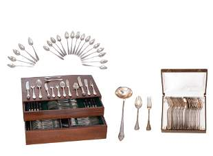 A silver cutlery set, containing twelve forks and