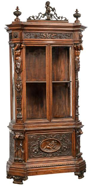 A richly sculpted walnut Renaissance style display