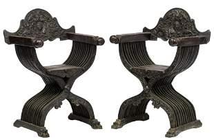 A pair of carved walnut Renaissance-inspired Savonarola