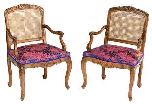 A fine pair of richly carved walnut Louis XV period
