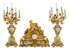 A very imposing Neoclassical ormolu bronze three-piece
