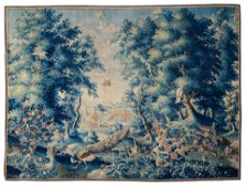 An 18thC verdure wall tapestry depicting peacocks,