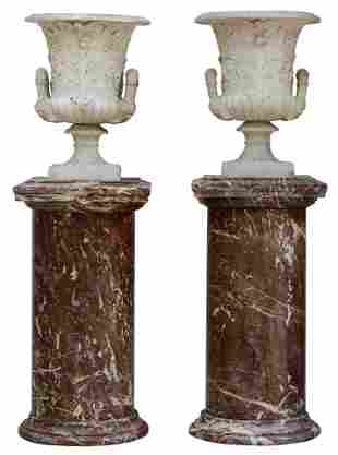A very finely sculpted pair of Carrara marble Medici
