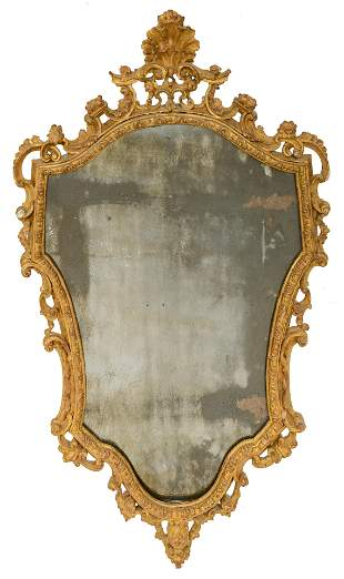 A gilt and finely carved Baroque Venetian wall mirror,