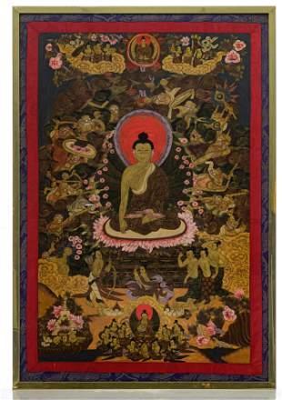 A Sino-Tibetan Thangka, mounted within silk embroidery