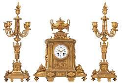 A fine gilt bronze Neoclassical three-piece clock