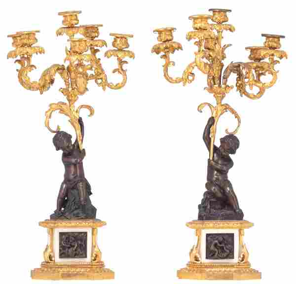 A fine pair of Neoclassical candelabras, decorated with