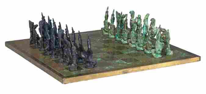 A Giacometti inspired bronze chess set, 40 x 40 cm…