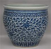 A fine Chinese blue and white floral cachepot, 19thC, H