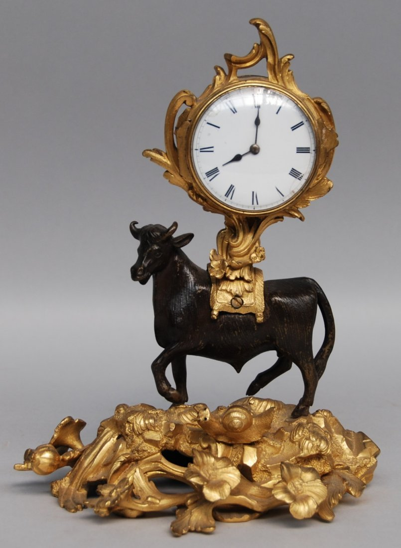 A gilt and patinated bronze mantel clock, Rococo style,