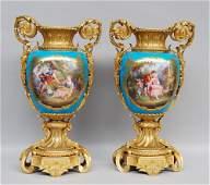 A fine pair of Sèvres vases, bleu céleste ground,