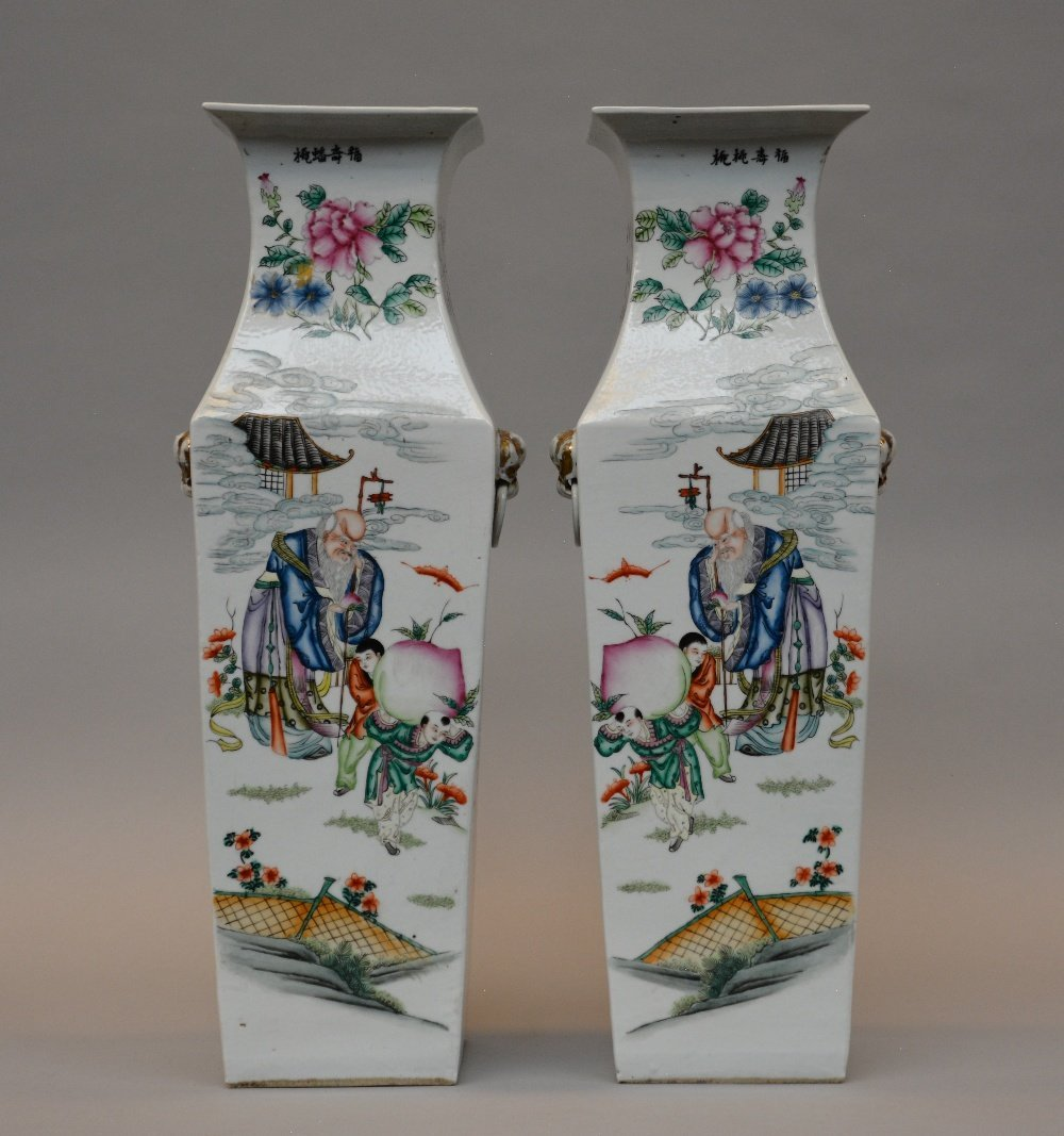 An exceptional pair of Chinese quadrangular vases,