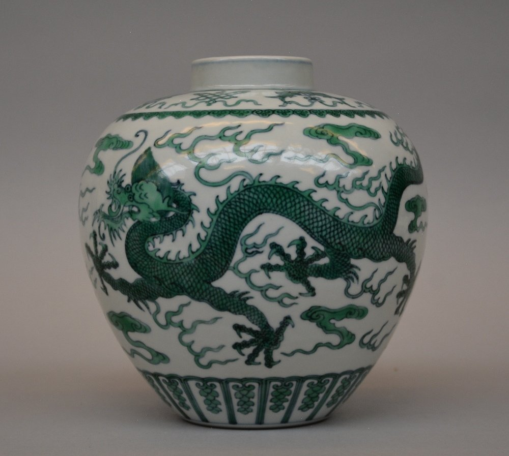 A Chinese 19thC green-glazed vase, painted with