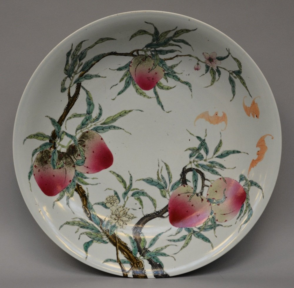 An exceptional Chinese plate with nine peaches design,